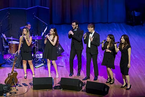 Vocal group performs live on stage