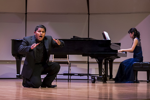 Vocalist and Pianist perform on stage
