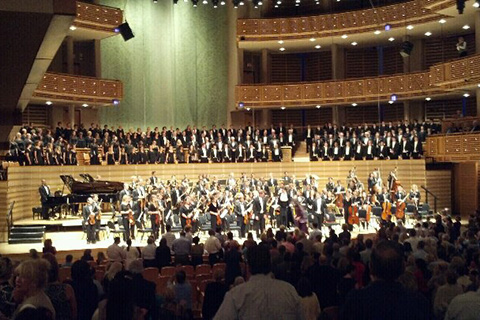 Choir and Orchestra play on stage